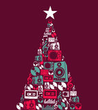 Christmas music objects tree. Dj music retro icon set in Christmas pine tree shape illustration background. Vector illustration layered for easy manipulation and Royalty Free Stock Photo