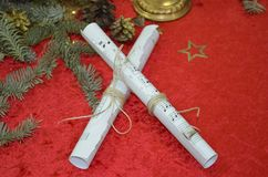 Christmas Music. Sheets of musical symbols. Photo of sheets music and Christmas decorations stock image