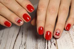 Christmas Nail art manicure. Holiday style bright Royalty Free Stock Photography