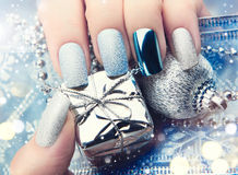 Christmas nail art manicure idea. Winter holiday manicure design Royalty Free Stock Image