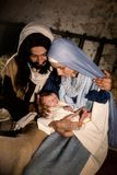 Christmas nativity in a barn. Live Christmas nativity scene in an old barn - Reenactment play with authentic costumes.  The baby is a property released doll Royalty Free Stock Image