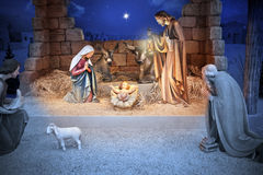 Christmas Nativity Jesus Birth. A Christmas nativity scene in a stable with baby Jesus in a manger, Mary and Joseph. The star of bethlehem is in the sky stock images