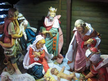 Christmas nativity, Jesus birth.Three Kings. The three wise men or kings with gifts for baby Jesus in the manger. Mary, Joseph and the shepherd watch on Stock Image