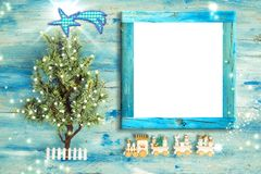 Christmas Nativity photo frame greetings. Christmas tree and vintage style wooden train with empty photo frame to put photo or message royalty free stock images