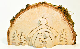 Christmas Nativity Scene. Cut out of  birch tree slice showing christmas nativity: Mary, Joseph, baby Jesus Royalty Free Stock Photo