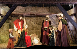 Christmas Nativity Scene. With Three Wise Men Offering Gifts to Baby Jesus, Mary and Joseph stock photo