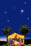 Christmas nativity scene. Holy family with three worshipping wise-men are admiring baby Jesus. The biggest star is pointing on the holy place. Sky area can be Stock Photos