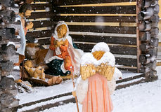 Christmas nativity scene, angel with lamb in the snow Royalty Free Stock Photography