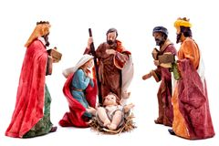Christmas nativity scene with the Holy Family and the three wise men, isolated on white background. Christmas nativity scene. Baby Jesus in the manger with Mary royalty free stock image