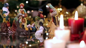 Christmas nativity scene with candles stock footage