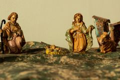 Christmas nativity scene. In the house, inside the hall, with papier-mache and small wooden statues stock photography