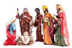 Christmas nativity scene with the Holy Family and the three wise men, isolated on white background royalty free stock photography