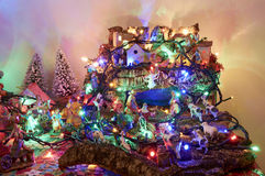 Christmas Nativity scene illuminated in the intimacy of the family Royalty Free Stock Images