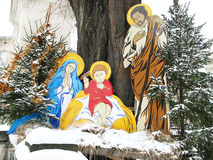 Christmas nativity scene of jesus birth with joseph and mary. Christmas nativity scene of jesus birth with joseph and mary in the winter day. Trees and building stock photography
