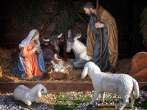 Christmas. Nativity scene with life size statues and and baby Jesus Royalty Free Stock Image