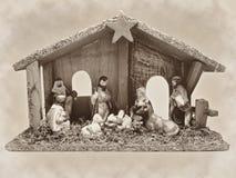 Christmas nativity scene manger with figurines including Jesus, Mary, Joseph, sheep and magi sepia Stock Photo