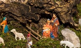 Christmas nativity scene represented with statuettes of Mary, Joseph and baby Jesus.  Royalty Free Stock Image