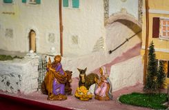 Christmas nativity scene represented with statuettes of Mary, Joseph and baby Jesus.  Royalty Free Stock Photo