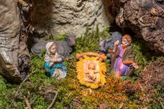 Christmas nativity scene represented with statuettes of Mary, Joseph and baby Jesus.  Royalty Free Stock Images