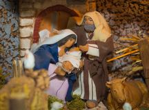 Christmas nativity scene represented with statuettes of Mary, Joseph and baby Jesus.  Stock Photos
