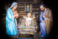 Christmas nativity scene. Represented with statuettes of Mary, Joseph and baby Jesus royalty free stock image