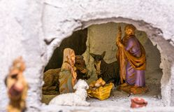 Christmas nativity scene represented with statuettes of Mary, Joseph and baby Jesus.  Royalty Free Stock Photography