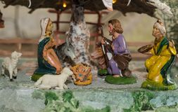 Christmas nativity scene represented with statuettes of Mary, Joseph and baby Jesus.  Stock Photography
