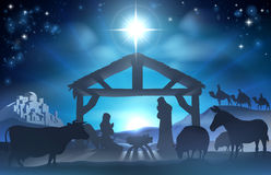 Christmas Nativity Scene. Traditional Christian Christmas Nativity Scene of baby Jesus in the manger with Mary and Joseph in silhouette surrounded by the animals Royalty Free Stock Photos