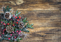Christmas natural decoration with pine cones, fir branches and red berries Stock Photos