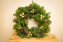 Christmas natural wreath with natural decorations - pinecones, tangerines, dried apples. Close up royalty free stock images