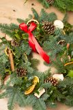 Christmas natural wreath with natural decorations - pinecones, tangerines, dried apples. Close up stock photos