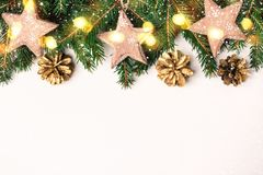 Christmas Nature Border of Fir Branches, wooden star toys and bokeh lights.  stock images