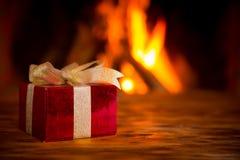 Christmas near fireplace Royalty Free Stock Image
