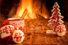 Christmas near fireplace Royalty Free Stock Image