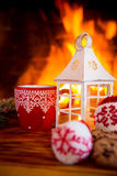 Christmas near fireplace Royalty Free Stock Photo