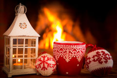 Christmas near fireplace Royalty Free Stock Photography
