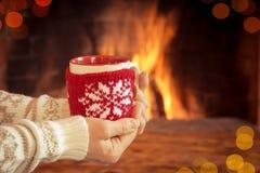 Christmas near fireplace Royalty Free Stock Photos