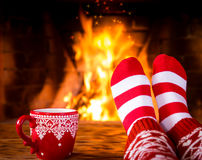 Christmas near fireplace Royalty Free Stock Images