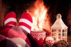 Christmas near fireplace Stock Photos