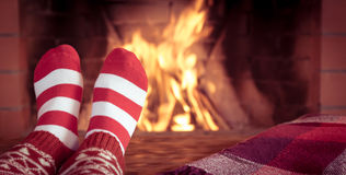 Christmas near fireplace Royalty Free Stock Photos