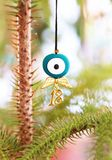 Christmas necklace with evil eye and angel wings stock photo