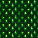 Christmas net lights garland. Green shine on the dark background Royalty Free Stock Photos