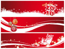 Christmas and new year. Banner of christmas and new year 2010 decorations with number balls and sleigh of santa claus on a red background Royalty Free Stock Image