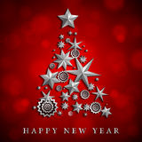 Christmas and New Year abstract with Christmas Tree made of stars and snowflakes on red ambient blurred background Stock Image