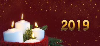 Christmas and New Year advent candles with a burning flame concept stock image