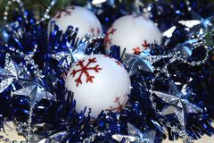 Christmas and New Year background. Christmas balls, blue tinsel and silvery shining stars. Stock Photo