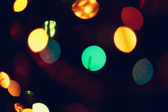 Christmas, New Year background with beautiful bokeh of colorful garland lights.  Stock Photos