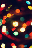 Christmas, New Year background with beautiful bokeh of colorful garland lights.  Royalty Free Stock Photography