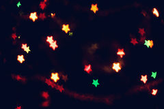 Christmas, New Year background with beautiful stars bokeh of colorful garland lights Stock Photos
