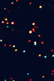 Christmas, New Year background with beautiful stars bokeh of colorful garland lights.  Stock Images